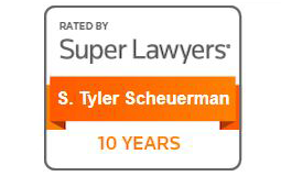 Rectangular rating stamp of Super Lawyers celebrating 10 years for S. Tyler Scheuerman